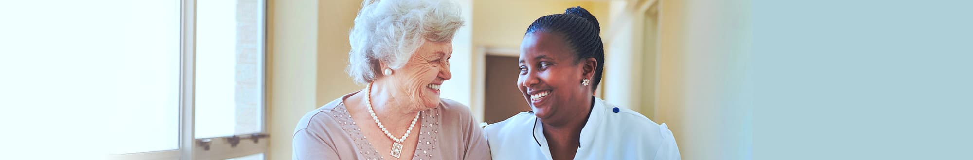 caregiver and nurse smiling