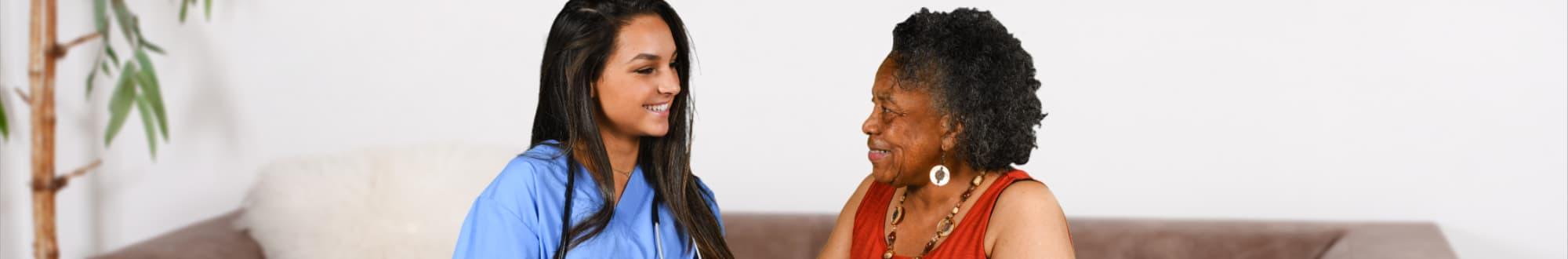 nurse and elder woman talking